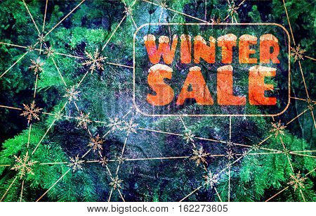 Winter sale inscription with snowflakes at the intersection of the lines. Retail business relative background. Grunge texture. Fir tree
