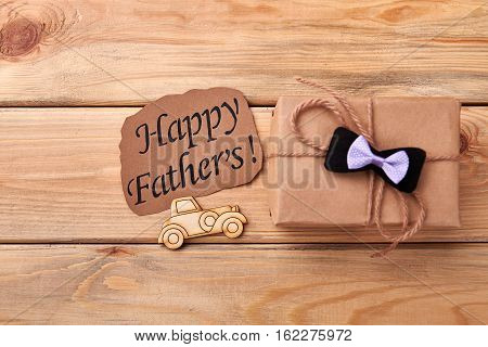 Happy Father's card and gift. Pyrography car near bow tie. Dad will appreciate your endeavor.