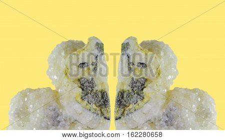 Double great calcite  crystal with pyrite isolated on yellow