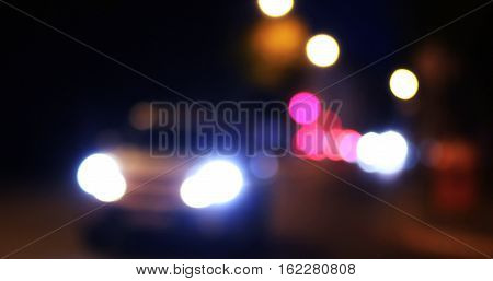 Retro toned blurred street and carlights, city abstract night time background.