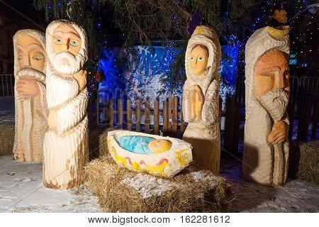 Christmas nativity scene with baby Jesus, Mary and Joseph in barn