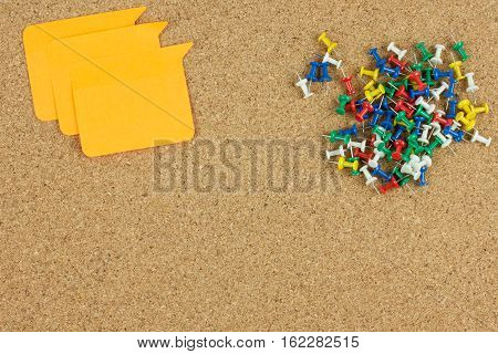 Paper note and push pin on brown board