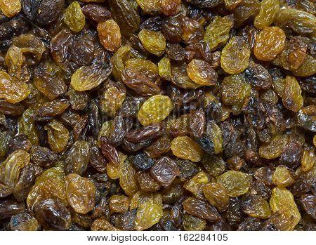Background dried raisin grapes eat closeup shot