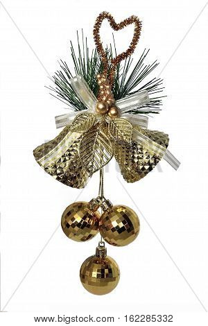 Golden christmas decoration - two bells with bow golden leaves green branch of fir tree and three baubles close up isolated on a white background