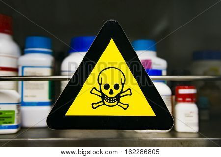 Focus at yellow label toxic chemicals in laboratory