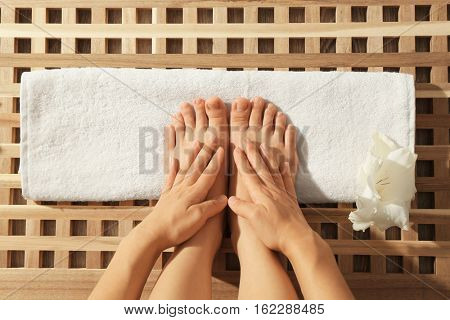Foot massage in spa, closeup