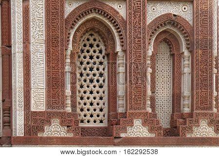 DELHI, INDIA - FEBRUARY 13 : Window with sunglow in Alai Minar, Qutab Minar complex, Delhi, India on February 13, 2016.