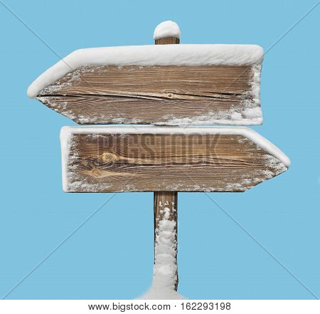 Wooden Direction Sign With Snow On Blue. Two_arrows-opposite_directions