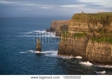 Cliffs of Moher in Ireland at sunset shot counter light