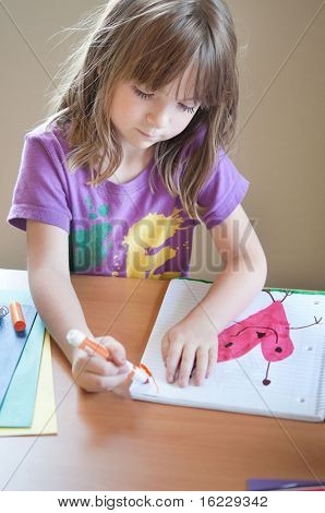 Little girl enjoying art class