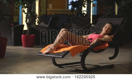 cute girl resting in Spa center on the sunbed
