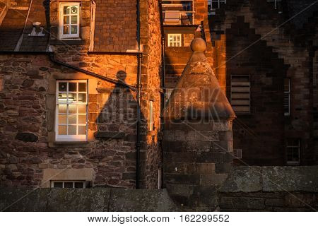 Wall details and cone shaped shadow of the stone building in Edinburgh