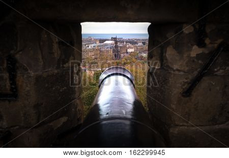 Edinburgh UK - November 06 2016: View on Scott Monument through the gun slit in the Edinburgh Castle