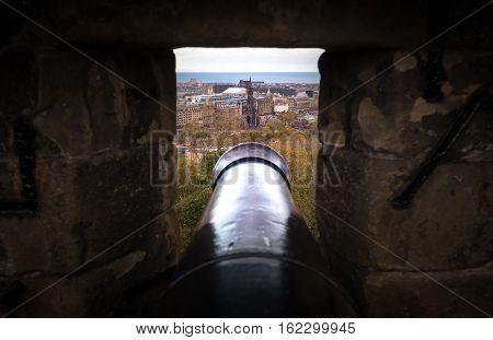 Edinburgh UK - November 06 2016: View on Scott Monument through the gun slit in the Edinburgh Castle