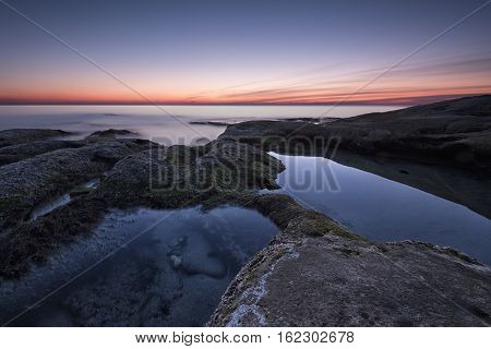 Seascape During Sunrise. Beautiful Natural Seascape, Blue Hour. Rocky Sunrise. Sea Sunrise At The Bl