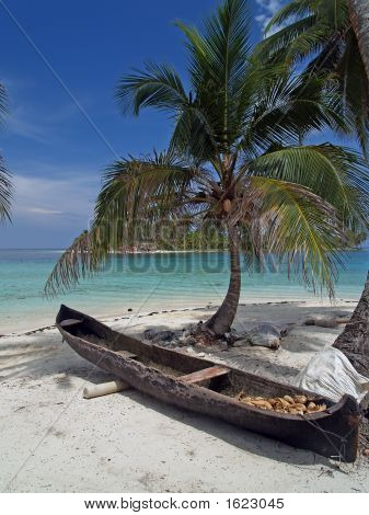 tropical white sand beach with a canoe laying on it poster
