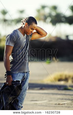 Young man with head down looking sad