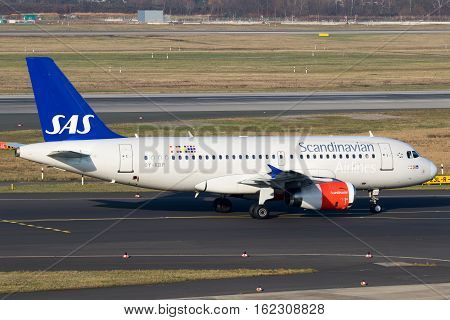 DUSSELDORF GERMANY - DEC 16 2016: Airbus A319 from SAS Scandinavian Airlines taxiing before take off from Dusseldorf airport