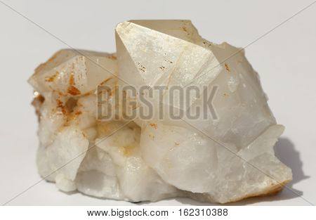 Bright calcite  crystal with white smooth surface