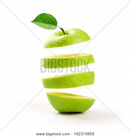 sliced green apple levitating on white background