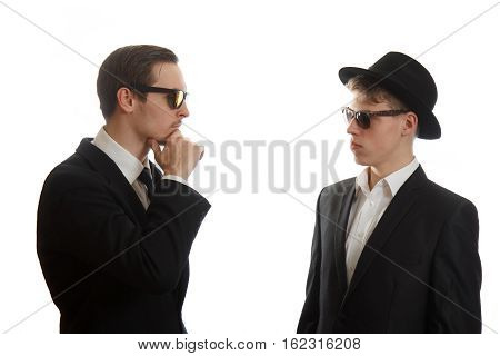 Two young businessmen meeting on white background