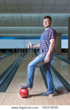 Happy man in bowling