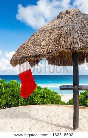 Christmas Stocking Hanging On Thatch Parasol