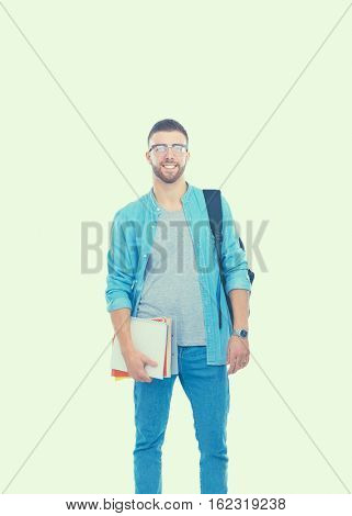 Male student with a school bag holding books isolated on white background