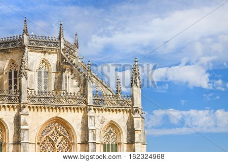 Detail of the facade of Batalha cathedral in Portugal (Europe) - image with copy space