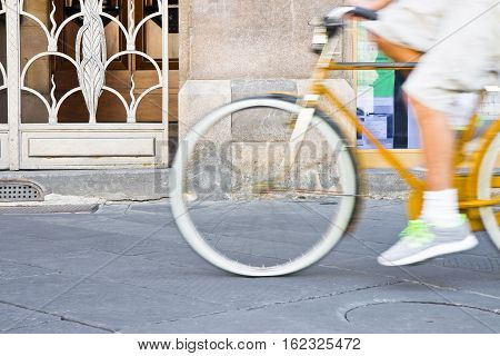 Cycling through the streets of the historic Italian cities centers