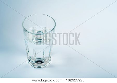 Glass of water on a light background