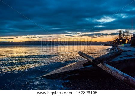 The sun is setting behind the Puget Sound in Washington State.