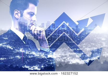 Businessman with chart arrows on blue city background. Finance concept Double exposure