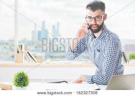 Businessman At Work Talking On Phone