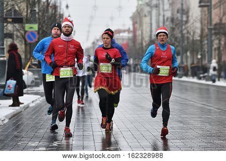 VILNIUS LITHUANIA - DECEMBER 18: Runners on traditional Vilnius Christmas race on 18 December 2016 in Vilnius Lithuania.