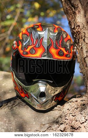 Flame painted bike racing helmet showing the scars and scratches of competition.