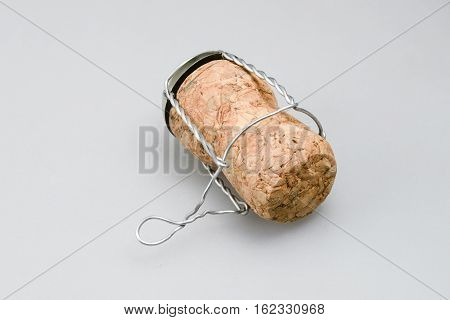 detailed single champagne cork on white background