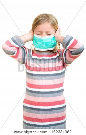 Beautiful sick girl protect flu by the mask for kid. Close up image of a cute kid with respiratory problem or flu. Adorable little sick girl with medical mask.