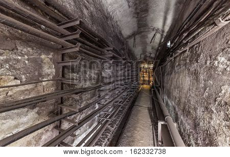 Old underground utility vault. Subway communication lines