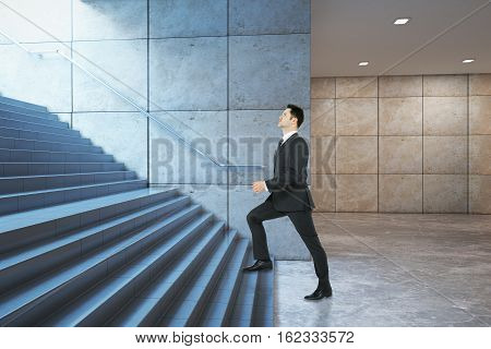 Success concept. Businessman climbing illuminated underground staircase with 'way out' sign. Side view 3D Rendering