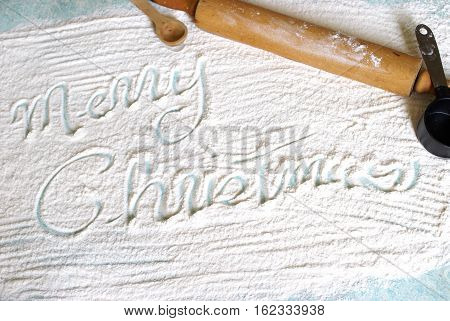 Creative Christmas greeting written during baking time in the flour.
