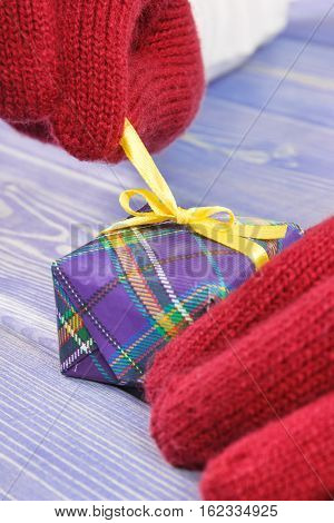 Hands Of Woman In Gloves Unpacking Gift For Christmas Or Other Celebration