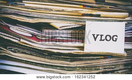 A Stack Of Old Newspapers, Words On A Paper Sticker
