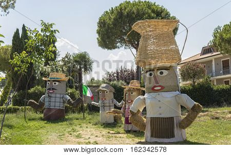 Lovely farmers family Puppets(straw dolls) made out of Hay Bale with typical peasant clothes