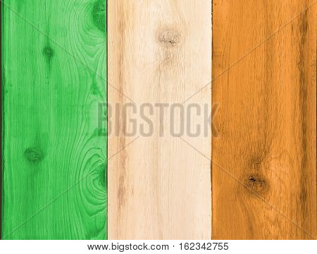 Timber planks of wood that have been painted or stained in the colors of a flag for Ireland or Eire as a background