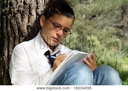 Girl studying outdoors