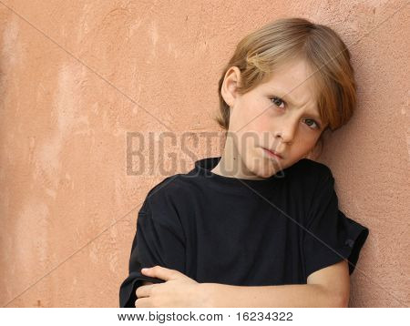 Little boy frowning,