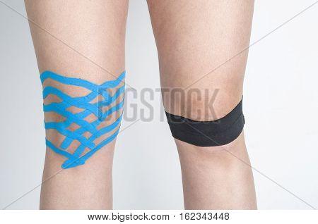 Lymphatic knee technique in both knees. Kinesiology Tape.