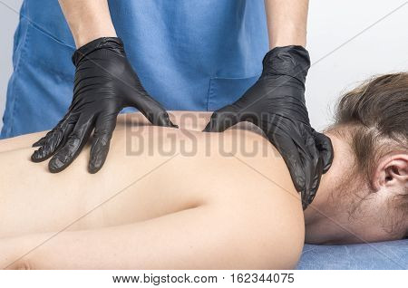 Physiotherapist, Chiropractor Giving A Massage To A Patient.