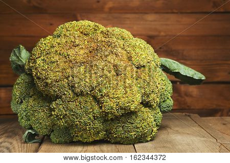 Fresh healthy useful broccoli vegetable on wooden table close up. Vintage toned